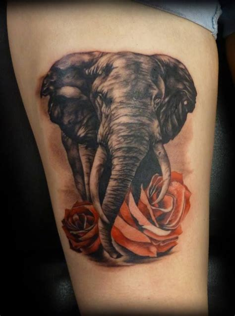 elephant tattoo on thigh elephant leg and roses let s get inked