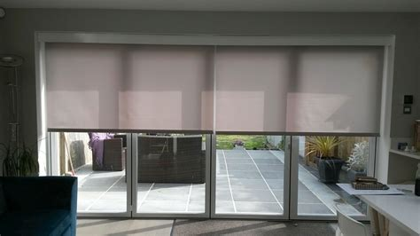 Bi Fold Patio Door Blinds Electric Blinds Covering Your Bifold Doors Will Reduce Heat Glare And Uv By Deans