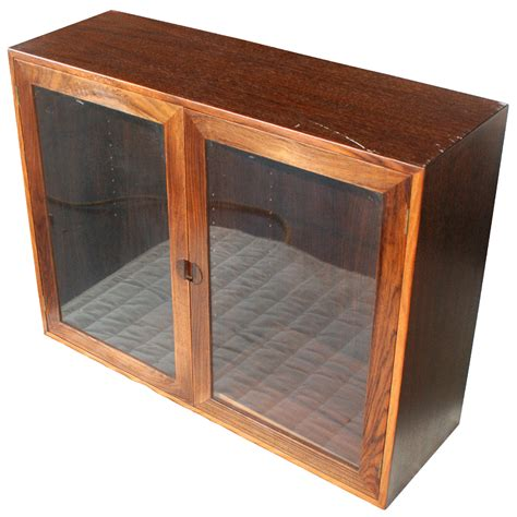 wall mounted glass cabinet pair of rosewood glass wall mounted cabinets ebay