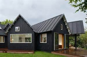 black house with metal roof homes house