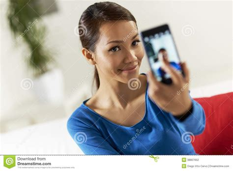 who is the asian girl in the mobile strike commercial asian girl sharing pictureon social network stock photo