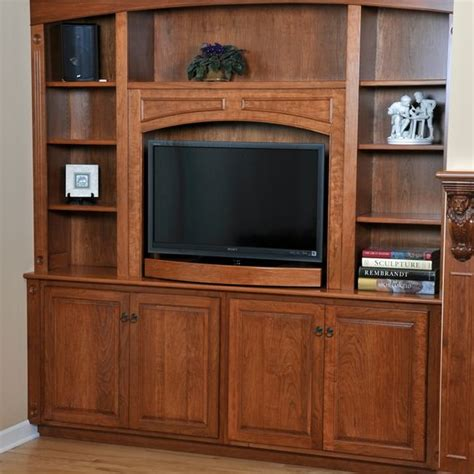 custom fireplace mantel and entertainment center by h m