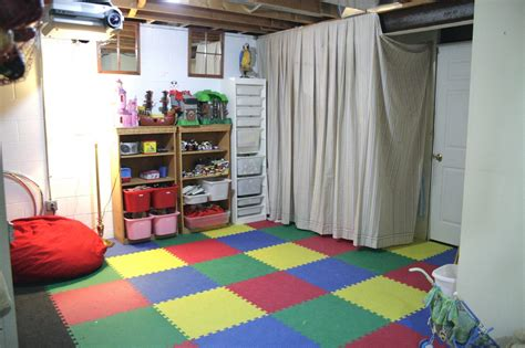 unfinished basement playroom ideas i am using several of these ideas like the curtain and floor
