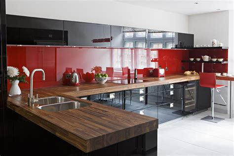 red and white kitchen backsplash quotes black red high gloss lacquer cupboards red kitchens
