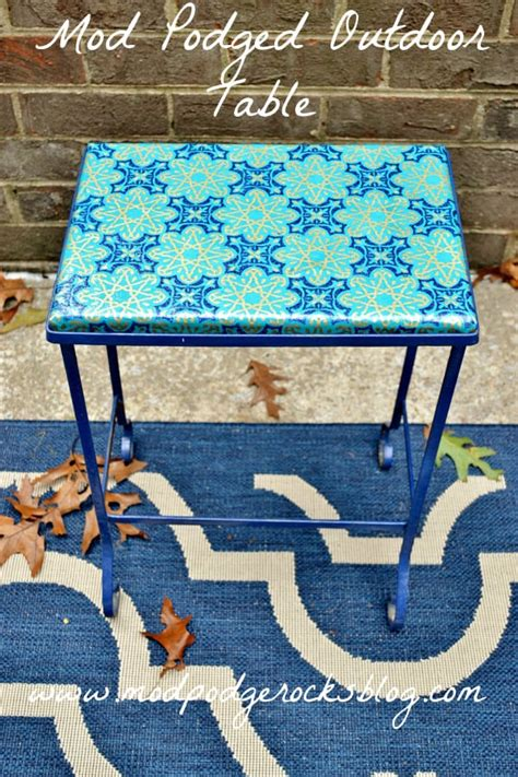 mod podge outdoor tabletop with wrapping paper mod podge