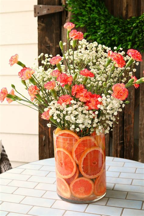 Wonderful Church Office Decorating Ideas #10: Red-grapefruit-and-pink-carnations-make-a-sweet-smelling-floral-arrangement.jpg