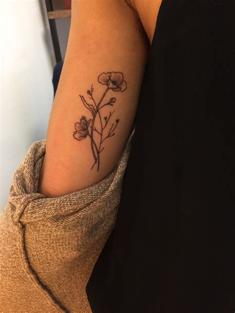wildflower tattoo meaning 28 on inner arm bicep tattoos for