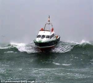 driving boat in waves after the floods uk weather sees more storms and driving