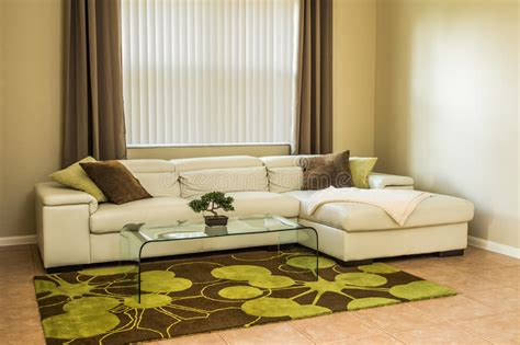cozy brown leather sofa for yellow living room design cozy living room in olive green colors stock photo image