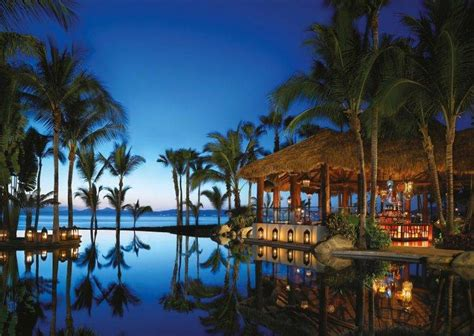 evening swimming pool palm trees resort sea beach