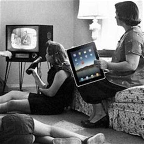 you sitting on the couch watching tv nielsen 40 percent of people use smartphones tablets