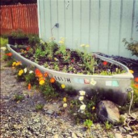 old boat flower bed boat planter on pinterest old boats planters and boats