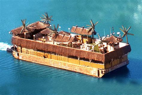 How To Build A Tiki Hut Rent This Surreal Tikki Beach Barge Complete With Huts And