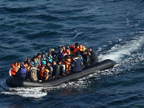 refugee boat sinks italy rescuers unable to help 31 refugees who drowned due to