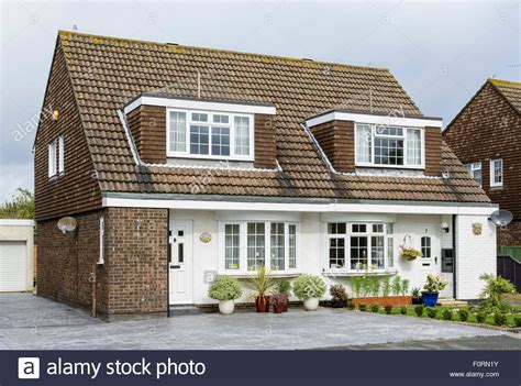 buy house in england dormer windows on a semi detached house in england uk stock photo royalty free image