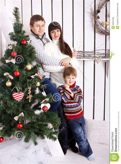 nearby christmas tree family near the tree stock photography image 35697592