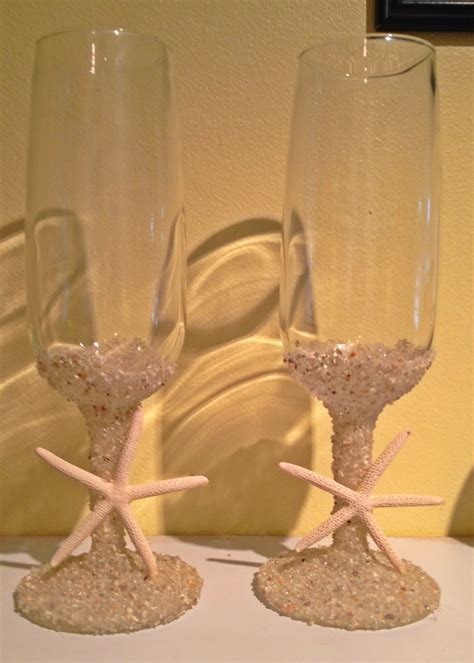Buy 2 champagne flutes or wine glasses (mine are from the