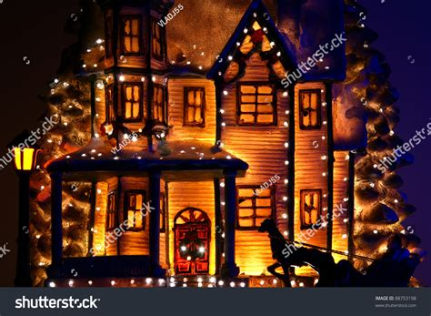 house decorated with lots of christmas lights stock photo