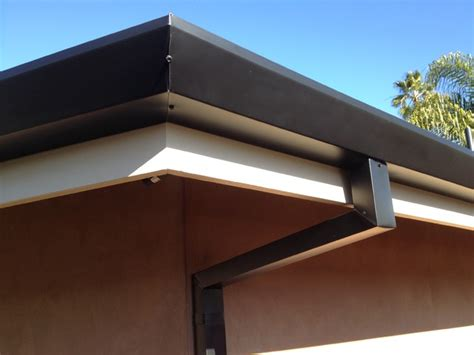 Remodeling A House by Custom Cut Downspouts With Contemporary Rain Gutters In