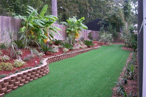 Tropical Backyard Landscaping Ideas with Lake Olmstead Backyard Tropical Landscape Other Metro By Pines Landscaping Llc