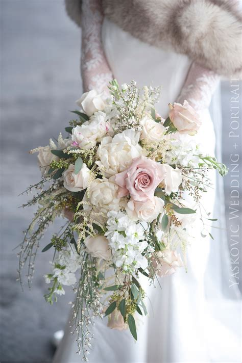 Bridal Bouquet by Exquisite Cascading Ivory And Pale Pink Winter Wedding