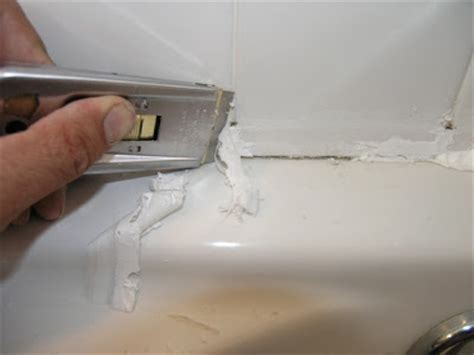 remove caulking from bathtub dover projects how to caulk a bathtub