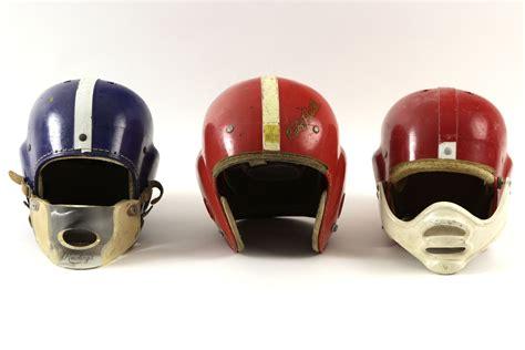 lot detail 1950 s football memorabilia collection w suspension helmets pants shoulder pads