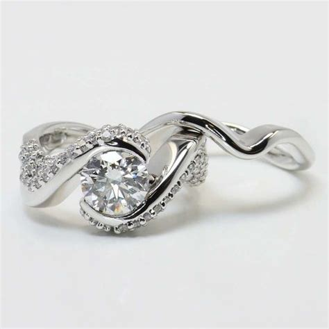 twisted engagement ring and matching band in white