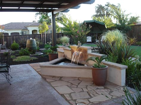 river city landscaping water feature with stucco and tile back splash traditional patio sacramento by river