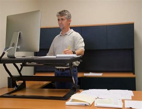 using a sit stand desk how to use a sit stand desk sun rehabilitation
