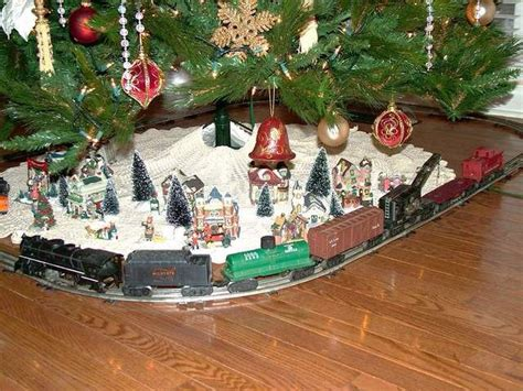cute train town scene set up under the christmas tree
