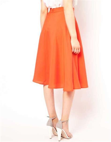 connection midi skirt in orange lyst