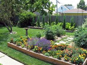 large backyard house design with wood raised bed with various flowers plants and garden with