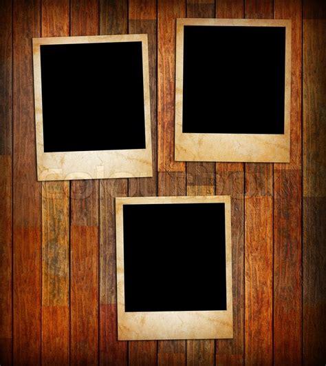 Wood Frame Poster 253 grunge vintage photo frames on a wood texture background