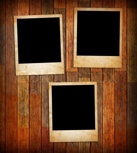 Grunge vintage photo frames on a wood texture background