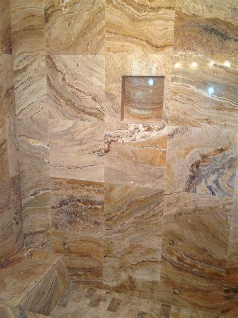leonardo polished travertine tiles in shower bathroom