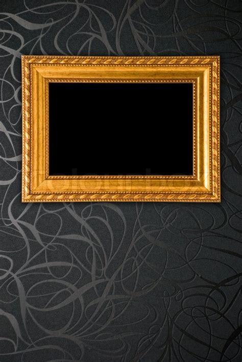 gold frame  black vintage wallpaper stock photo
