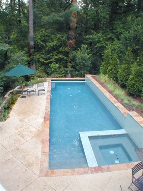 Lap pool fits on long skinny lot. Walls above and below