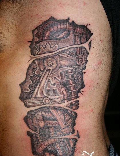 biomechanical tattoo ideas ripped skin tattoo designs mind blowing ripped skin