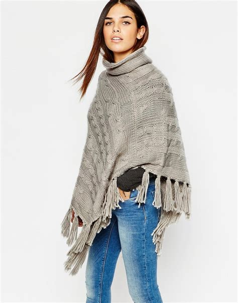 warehouse warehouse cable knit poncho with tassel hem at