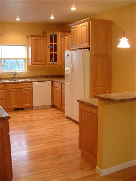 kitchen floors with oak cabinets wood floors