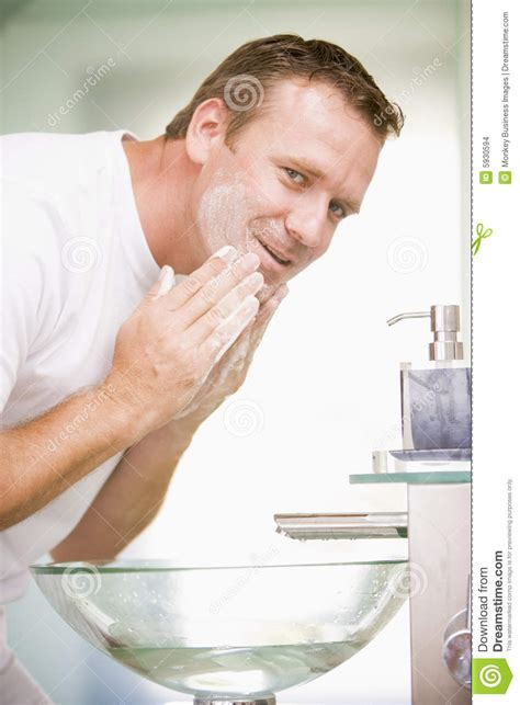 bathroom facial man in bathroom washing face stock images image 5930594