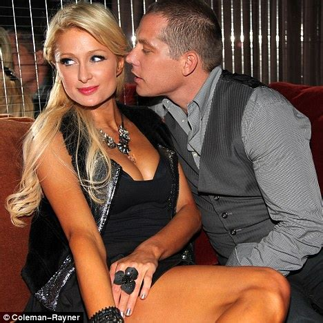 paris hilton gets showered with kisses by her new man in