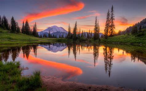 tipsoo lake  washington sunset mountain snow forest sky water reflection