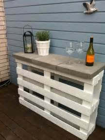 Garden Bar Table 2 Pallets 3 Pavers White Paint A Great Outdoor Shelf Bar Or Garden Table This Is