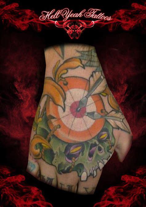 tattoo ink target new school skull hand target tattoo by hellyeah tattoos