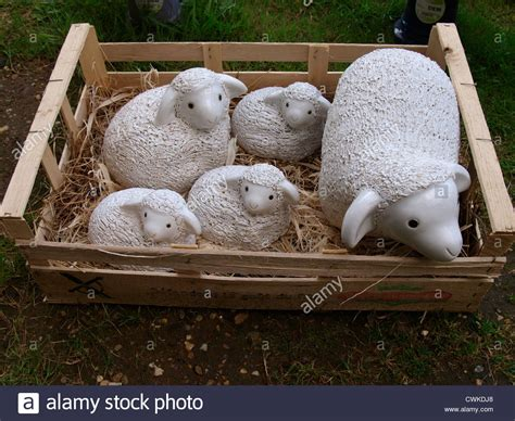 lamb and sheep garden ornaments in a box uk stock photo
