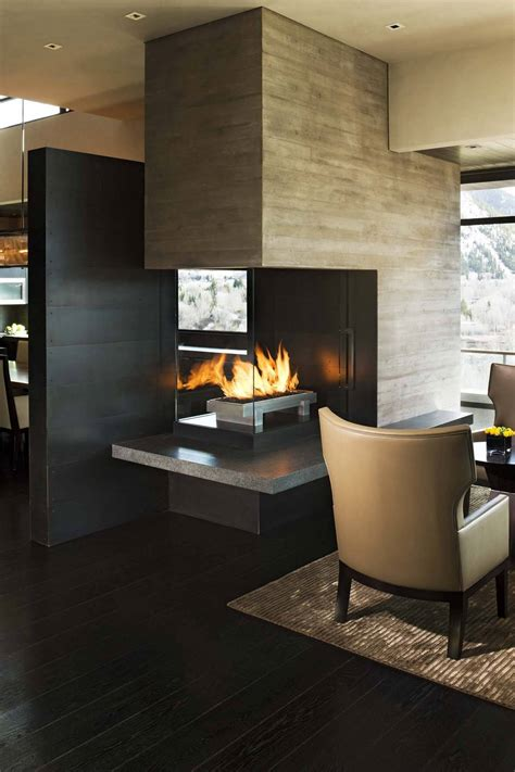 room fireplace seperating wall with 3 way fireplace between dining and