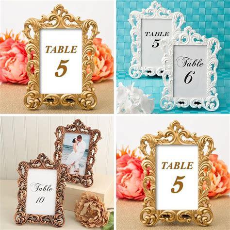 wedding table number holders   Wedding Decor Ideas