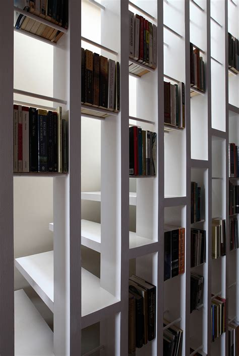staircase bookshelves a new staircase does double duty as a bookcase moco loco